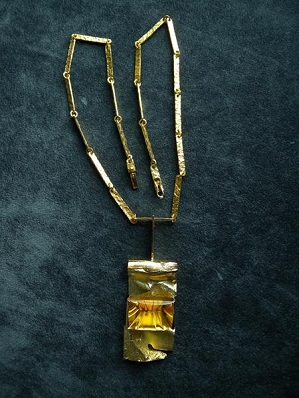 Gold necklace with citrin designed by Bjorn Weckström